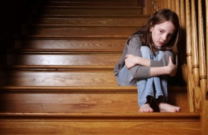 sad-child-on-stairs