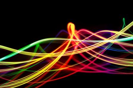 a rainbow pattern of twisting light blurs